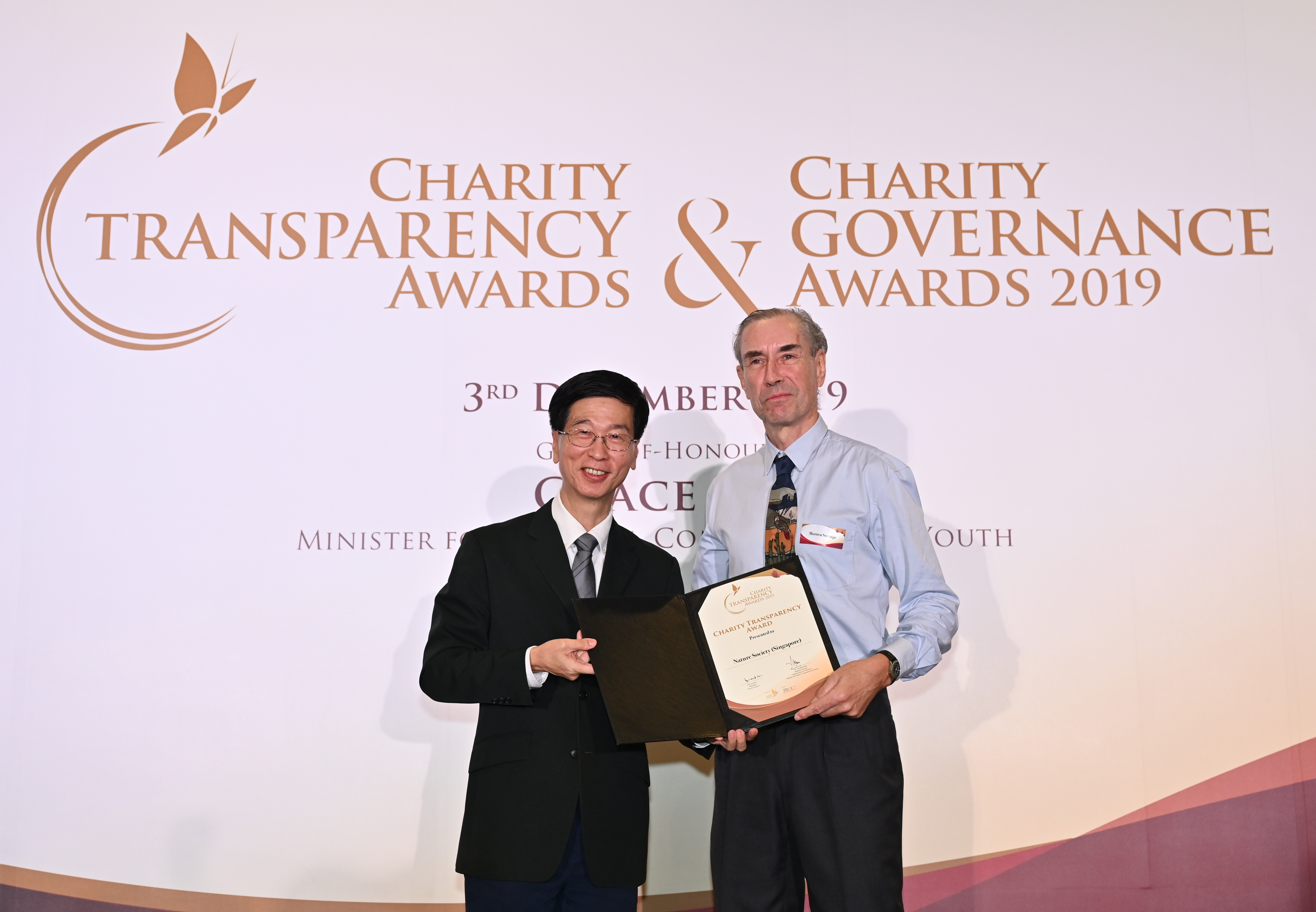 Charity Transparency Award 2019 Morten Strange and Commissioner of Charities Dr Ang Hak Seng.png.jpg